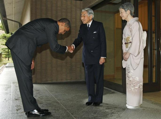 U.S. President Barack Obama is greeted by Japanese Emperor Akihito and Empress Michiko upon arrival at the Imperial Palace in Tokyo